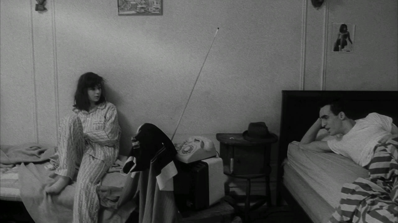 7 Art Cinema | Stranger than Paradise - 1984 - Jim Jarmusch | John Lurie as Willie, Eszter Balint as Eva, Richard Edson as Eddie, Cecillia Stark as Aunt Lotte, Danny Rosen as Billy, Rammellzee as Man With Money, Tom DiCillo as Airline Agent, Richard Boes as Factory Worker, Rockets Redglare, Harvey Perr and Brian J. Burchill as Poker Players, Sara Driver as Girl With Hat, Paul Sloane as Motel Owner | Directed by Jim Jarmusch, Produced by Sara Driver, Written by Jim Jarmusch, Starring, John Lurie, Eszter Balint, Richard Edson, Cecillia Stark, Music by John Lurie, Cinematography Tom DiCillo, Edited by Jim Jarmusch, Melody London, Production company Cinesthesia Productions Inc., Distributed by The Samuel Goldwyn Company, Release dates 1984, Running time 89 minutes, Country United States, West Germany, Language English, Hungarian | Photograph