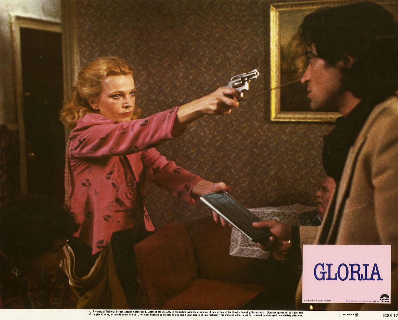 7 Art Cinema | Gloria - 1980 - John Cassavetes | Directed by : John Cassavetes, Written by  : John Cassavetes, Produced by : Sam Shaw et Stephen F. Kesten, Production : Columbia Pictures, Music by : Bill Conti, Cinematography : Fred Schuler, Edited by : George C. Villaseor, United States, Colors - 1,85:1 - Mono - 35 mm, Crime Thriller, 123 minutes, Release dates (US) : October 1, 1980 at New York, Release dates (France) : December 31, 1980, Cast, Gena Rowlands as Gloria Swenson, Julie Carmen as Jeri Dawn, Buck Henry as Jack Dawn, John Adames as Phil Dawn, Lupe Garnica as Margarita Vargas, John Finnegan as Frank, Tom Noonan, J.C. Quinn, and Sonny Landham as Mob henchmen, Lawrence Tierney as Broadway bartender | Film Photograph